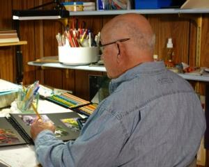 Carl Ray at the drawing board.